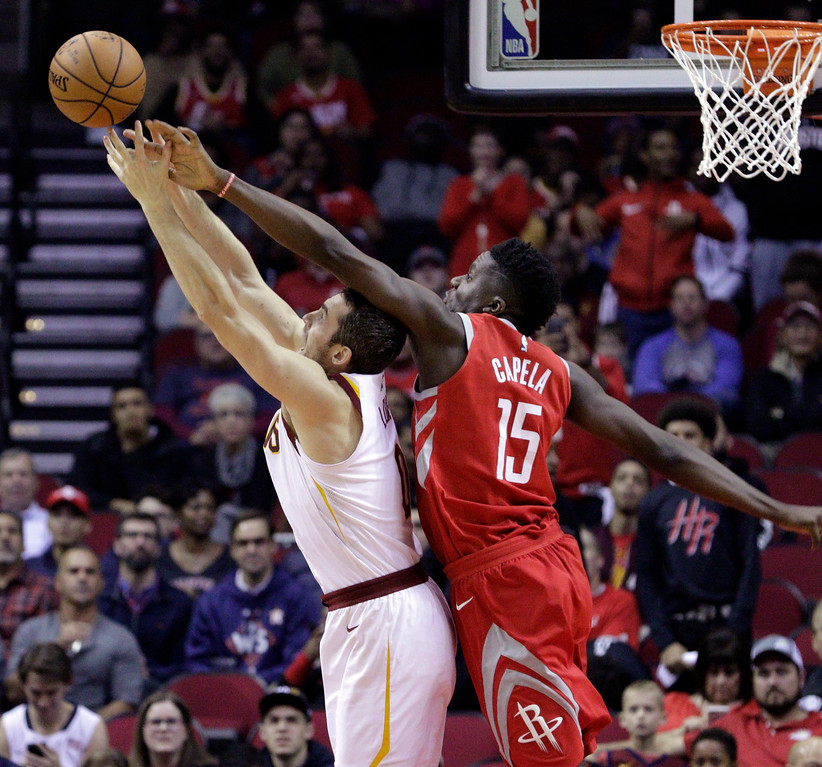. Cleveland Cavaliers forward Kevin Love (0) has a rebound knocked away by Houston Rockets center Clint Capela (15) during the first half of an NBA basketball game Thursday, Nov. 9, 2017, in Houston. (AP Photo/Michael Wyke)
