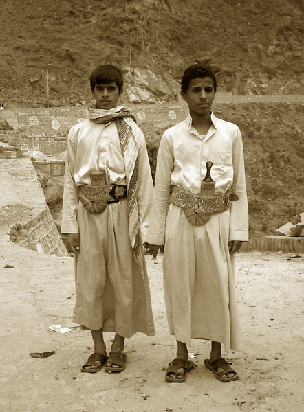 two young men in Manakha, one without his jambiya knife