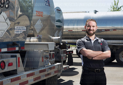 Wayne Levinson, president of Bulk FR8 in Seattle, is pictured among tanker trucks at a facility in Kent, Washington