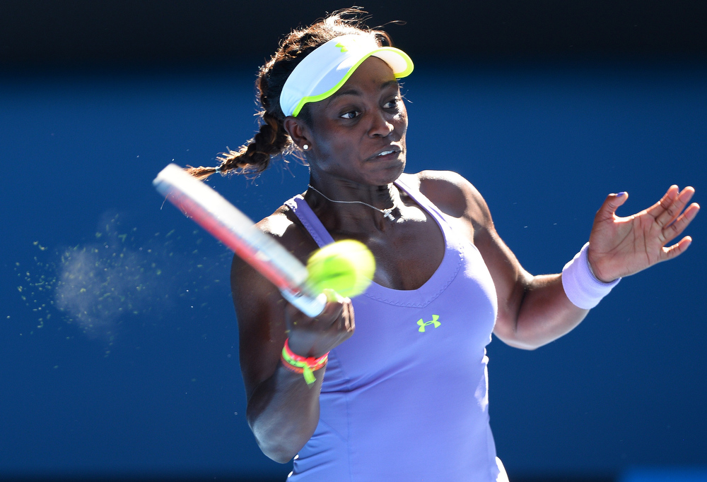 Description of . Sloane Stephens of the US hits a return against Belarus's Victoria Azarenka during their women's singles semi-final match on day 11 of the Australian Open tennis tournament in Melbourne on January 24, 2013.  WILLIAM WEST/AFP/Getty Images