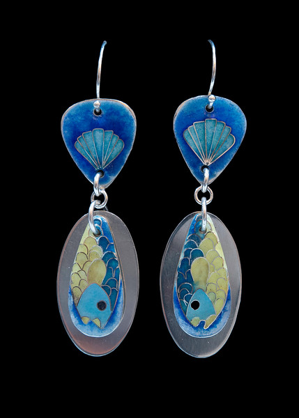 Cloisonné enamel fish earrings. Argentium silver oval behind the fish. Cloisonné tail attached with Argentium silver findings. Lots of movement, sparkle and sound.  Approximately 2 1/2 inches from top of ear wires to tip of silver oval. 150.00