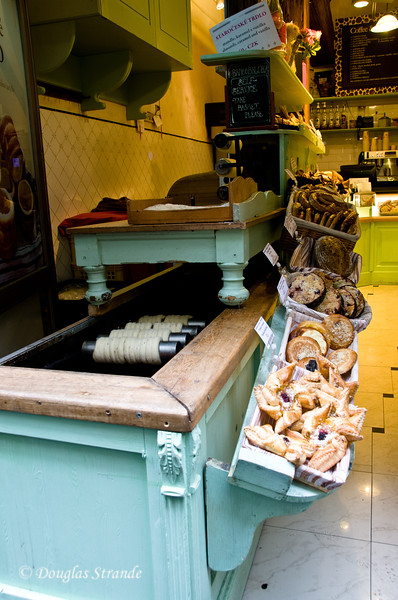 Trdelnik on rollers at a pastry shop in Old Town, Prague