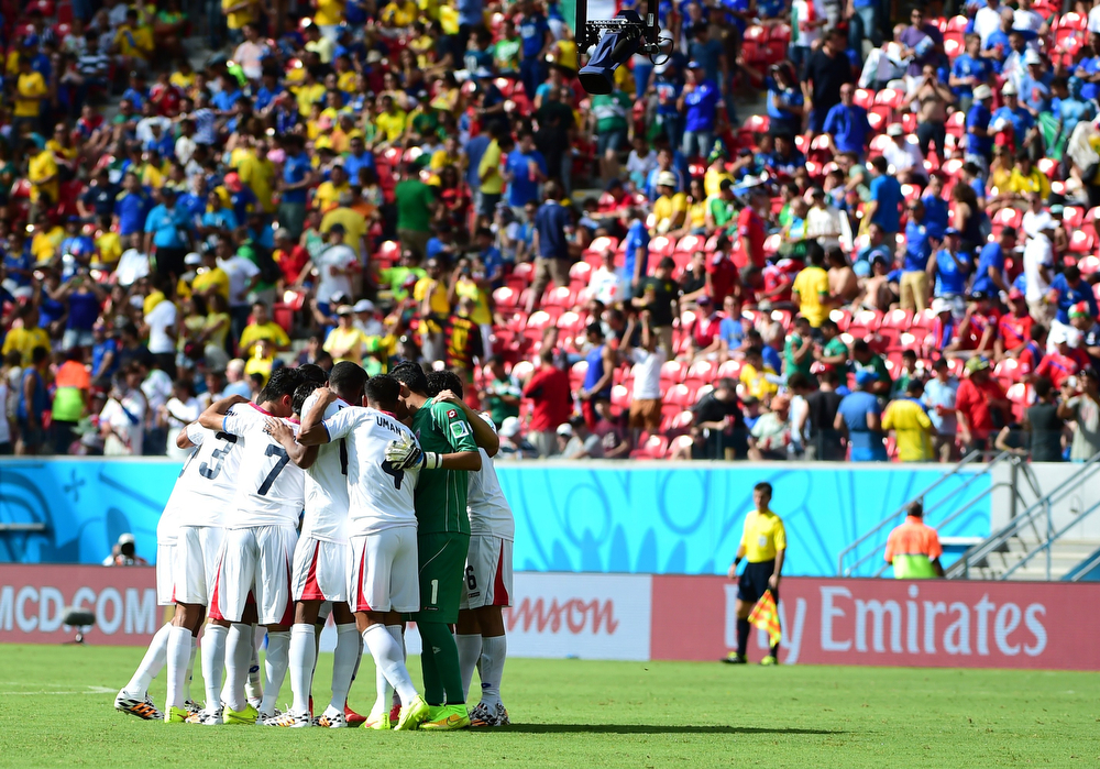 . The Costa Rica team form a huddle at the start of the second half during a Group D match between Italy and Costa Rica at the Pernambuco Arena in Recife during the 2014 FIFA World Cup on June 20, 2014. (RONALDO SCHEMIDT/AFP/Getty Images)