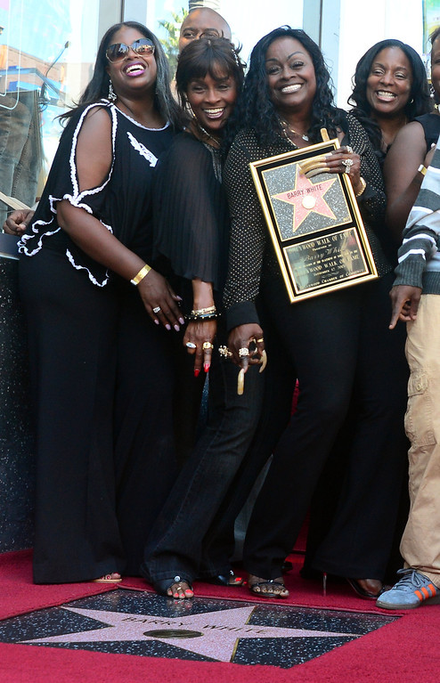 . The late Barry White\'s wife Glodean White (2/R) and family members pose following the unveiling of her husband\'s posthumous star along the Hollywood Walk of Fame on September 12, 2013. White, who died in 2003 and would have celebrated his birthday September 12, is most well known for his 1970\'s instrumental \'Love\'s Theme\' and is the recipient of the 2,506th Star in the category of recording.         (FREDERIC J. BROWN/AFP/Getty Images)
