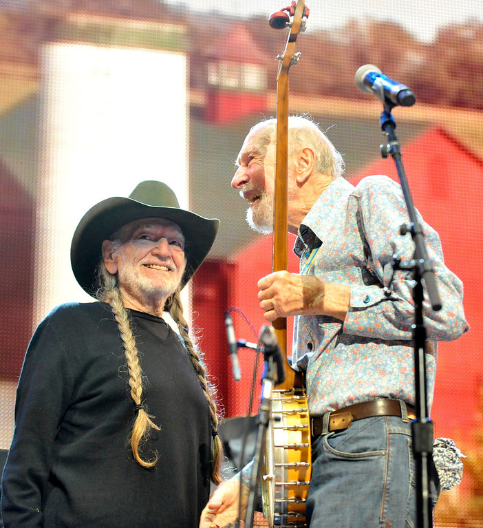 . File-This Sept. 21, 2013, file photo shows Pete Seeger, right, and Willie Nelson on stage during the Farm Aid 2013 concert at Saratoga Performing Arts Center in Saratoga Springs, N.Y.   The American troubadour, folk singer and activist Seeger  died Monday Jan. 27, 2014, at age 94.  (AP Photo/Hans Pennink)