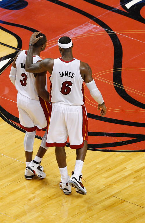 . Miami Heat\'s LeBron James (6) and Dwyane Wade during the second half of Game 7 of the NBA basketball playoffs Eastern Conference finals against the Boston Celtics, Saturday, June 9, 2012, in Miami. (AP Photo/Wilfredo Lee)