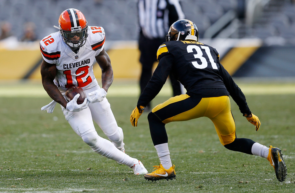. Cleveland Browns wide receiver Josh Gordon (12) runs after a catch with Pittsburgh Steelers defensive back Mike Hilton (31) defending during the second half of an NFL football game in Pittsburgh, Sunday, Dec. 31, 2017. (AP Photo/Keith Srakocic)