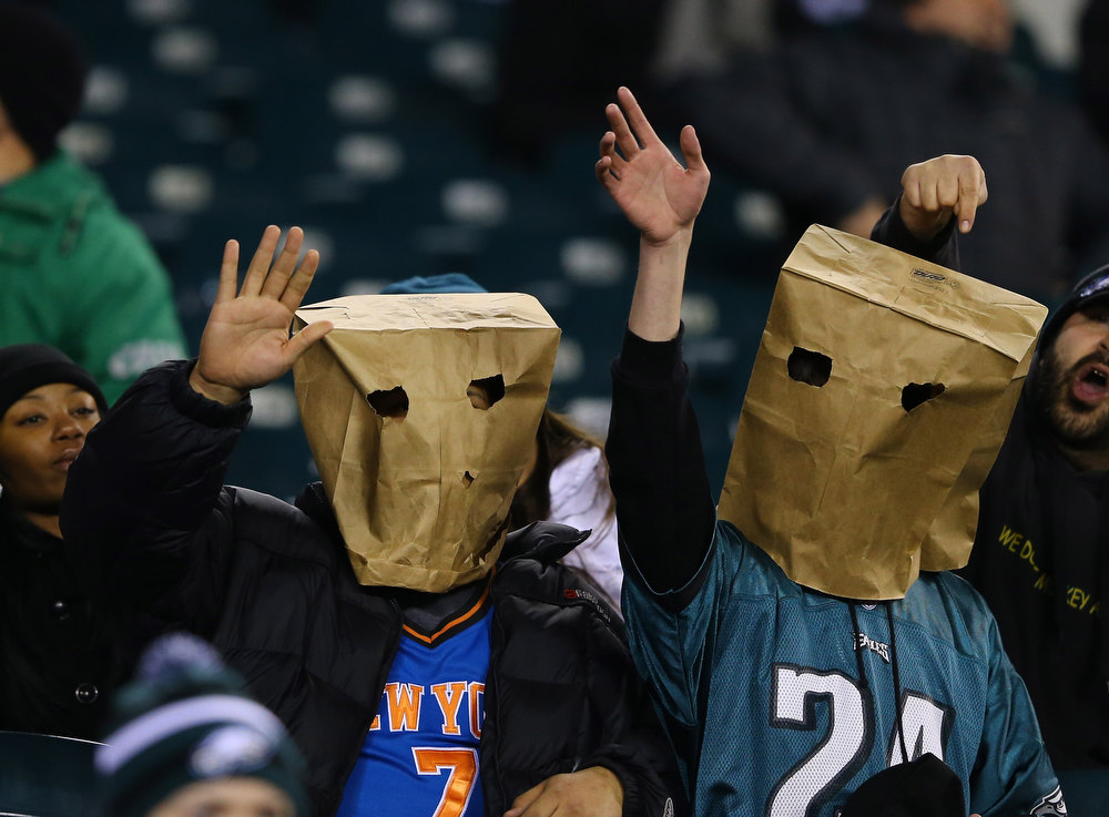 Description of . Philadelphia Eagles fans wear paper bags on their heads during their game against the Cincinnati Bengals at Lincoln Financial Field on December 13, 2012 in Philadelphia, Pennsylvania.  (Photo by Al Bello/Getty Images)