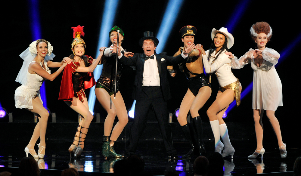 . Comedian Martin Short, center, and dancers perform a musical tribute to director Mel Brooks\' films during the American Film Institute\'s 41st Lifetime Achievement Award Gala honoring Brooks at the Dolby Theatre on Thursday, June 6, 2013 in Los Angeles. (Photo by Chris Pizello/Invision/AP)