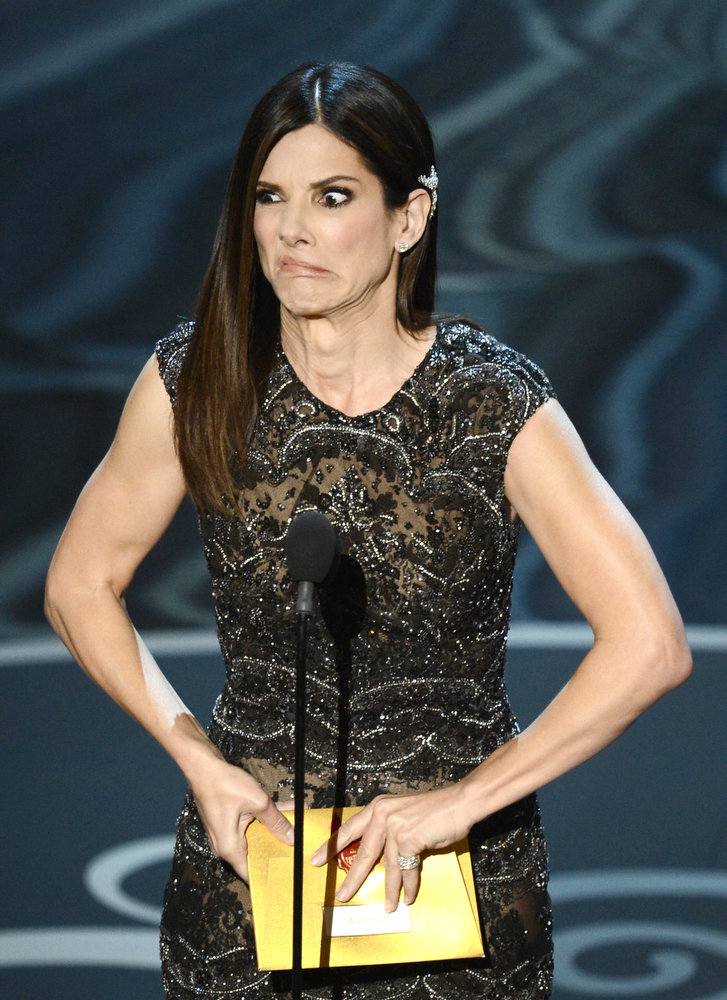 Description of . Actress Sandra Bullock presents onstage during the Oscars held at the Dolby Theatre on February 24, 2013 in Hollywood, California.  (Photo by Kevin Winter/Getty Images)