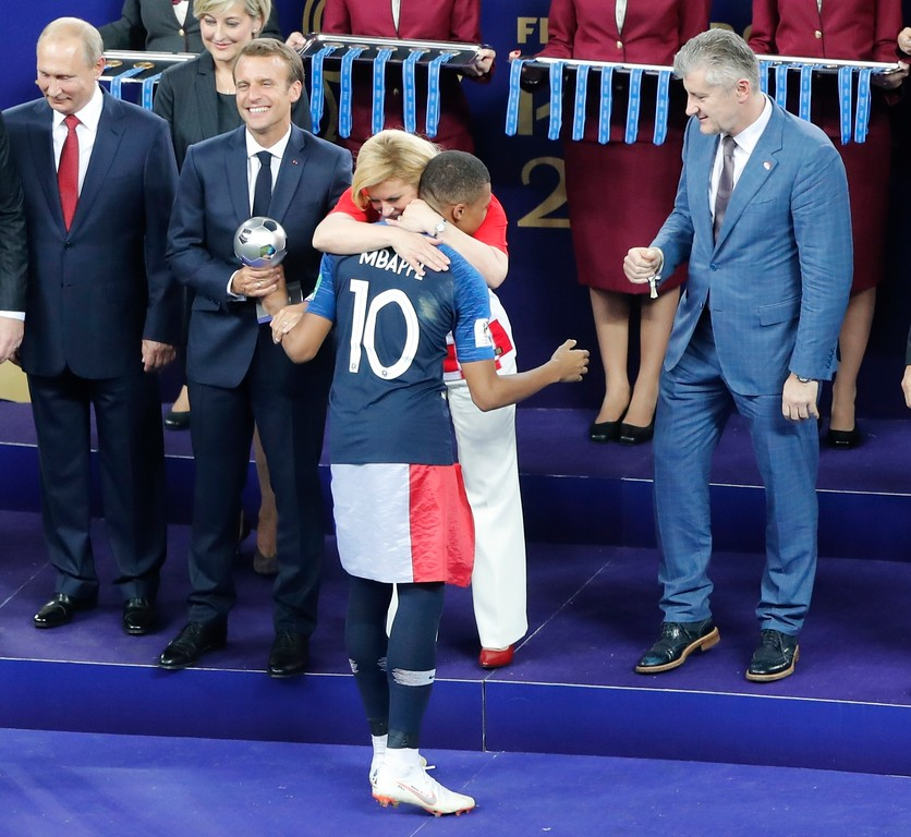 . Croatian President Kolinda Grabar-Kitarovic embraces France\'s Kylian Mbappe after he received the player of the tournament award after the final match between France and Croatia at the 2018 soccer World Cup in the Luzhniki Stadium in Moscow, Russia, Sunday, July 15, 2018. France won the final 4-2. (AP Photo/Frank Augstein)