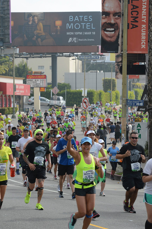 . Runners tree on Sunset in West Hollywood during the 28th Los Angeles Marathon.  Photo by David Crane/Staff Photographer