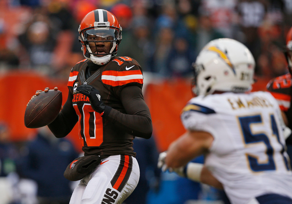 . Cleveland Browns quarterback Robert Griffin III (10) looks to pass in the first half of an NFL football game against the San Diego Chargers, Saturday, Dec. 24, 2016, in Cleveland. (AP Photo/Ron Schwane)
