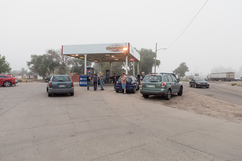 August 21, 2017. 07:01 am.  Our caravan of vehicles was separated due the unforeseen truck breakdown.  Some of us met here at The Trading Post gas station/convenience store in the tiny town of Bridgeport Nebraska. The Trading Post never had a run on gas, breakfast burritos and bathrooms quite like this morning.  Still foggy.
