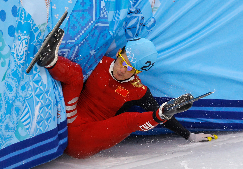 . Liang Wenhao of China crashes out in the men\'s 500m short track speedskating final at the Iceberg Skating Palace during the 2014 Winter Olympics, Friday, Feb. 21, 2014, in Sochi, Russia. (AP Photo/Vadim Ghirda)