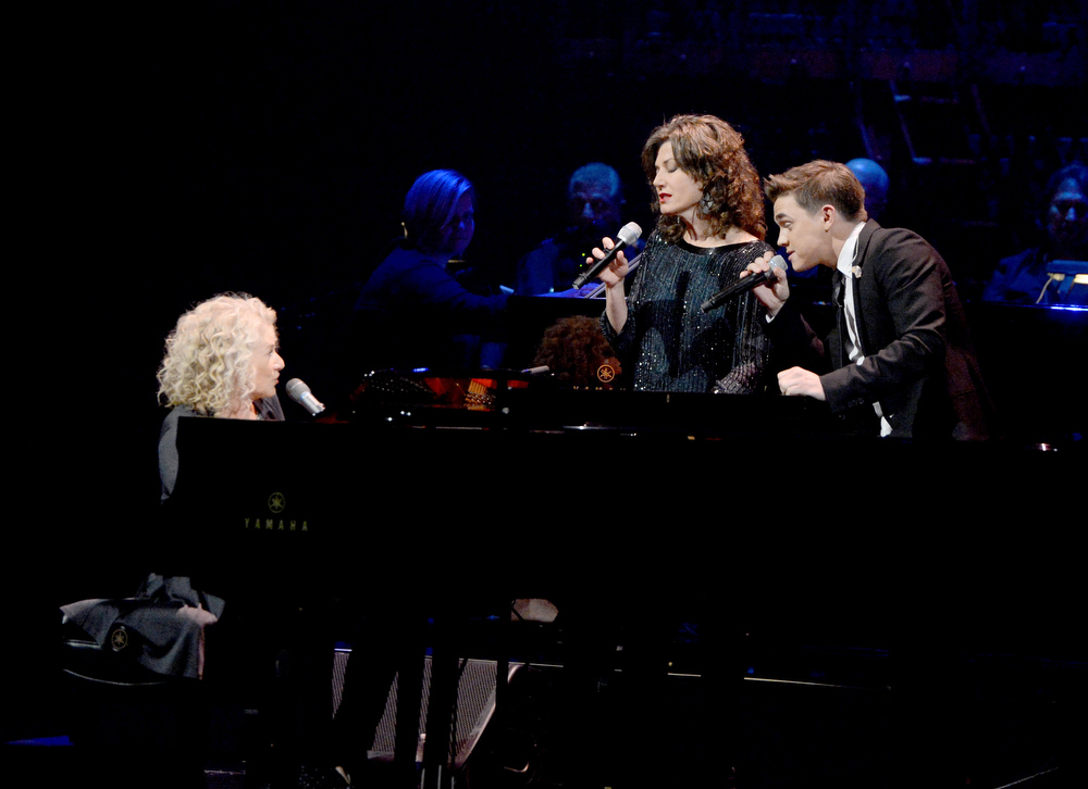 Description of . Singer/songwriter Carole King and singers Amy Grant and Jesse McCartney perform onstage during a celebration of Carole King and her music to benefit Paul Newman's The Painted Turtle Camp at the Dolby Theatre on December 4, 2012 in Hollywood, California.  (Photo by Michael Buckner/Getty Images for The Painted Turtle Camp)