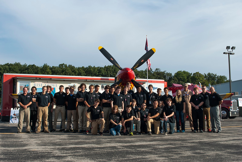 Toledo Public Schools Aviation Center students with Paul Stojkov in front of the Mustang and RISE ABOVE trailer