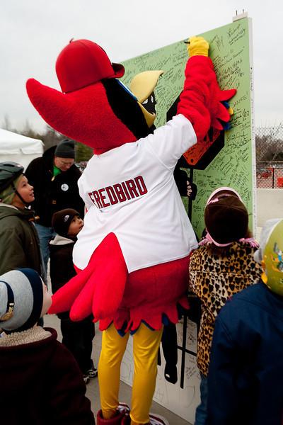 Fredbird Signs the Card
