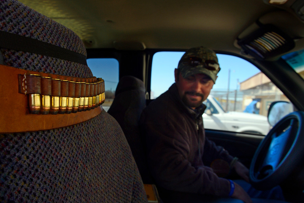 . ROCKY FORD, CO - FEBRUARY 25: Mac Holder sits in the cab of his truck where a belt containing an Ira Johnson .45 handgun is strapped with bullets in Rocky Ford. Gun owners in southern Colorado largely agree that responsible ownership begins at home. (Photo by AAron Ontiveroz/The Denver Post)