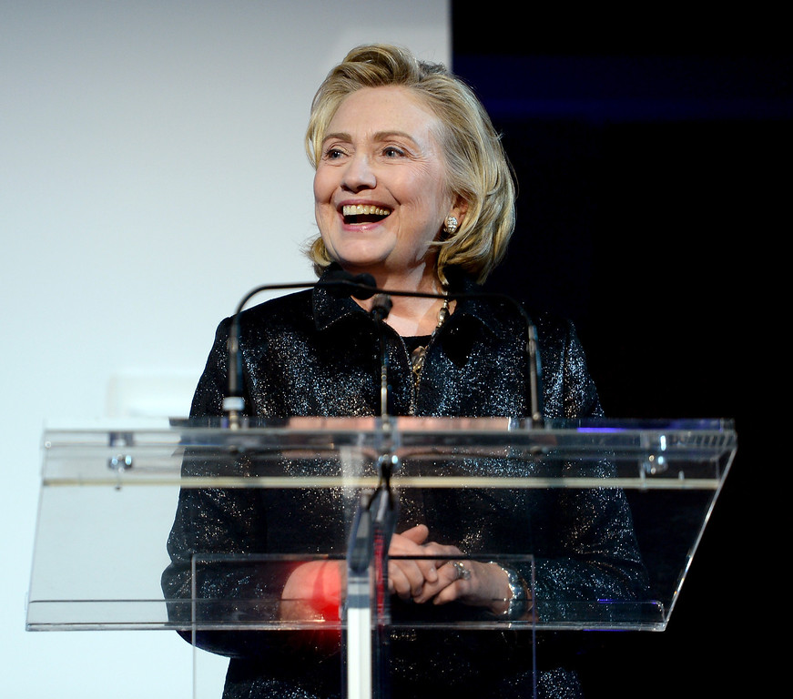 . NEW YORK, NY - OCTOBER 16:  (L-R) Hillary Rodham Clinton, recipient of the Michael Kors Award for Outstanding Community Service, speaks onstage at God\'s Love We Deliver 2013 Golden Heart Awards Celebration at Spring Studios on October 16, 2013 in New York City.  (Photo by Dimitrios Kambouris/Getty Images for Michael Kors)