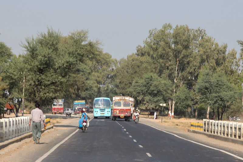 We're supposed to drive on the left in India. The oncoming traffic takes up the whole road to complete a pass at the last minute.
