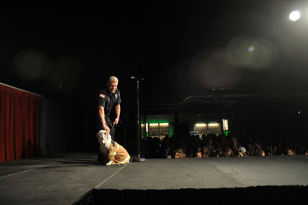 . DENVER, CO. - MAY 11: A firefighter and his dog introduce themselves to the audience at the 2014 Colorado Firefighter Calendar Tryouts at the Exdo Event Center in Denver, Colorado. Proceeds from the event and calendar sales benefit the Children\'s Hospital Colorado Burn Center and centers across the state. (Photo By Patrick Traylor/The Denver Post)