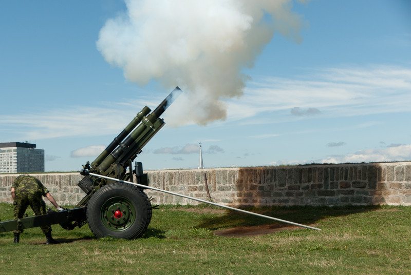 Firing a cannon at Citadelle in Quebec City, Quebec, Canada