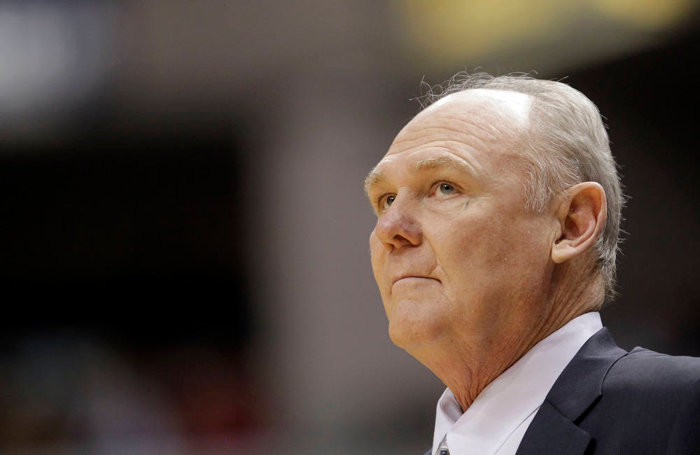 . Denver Nuggets head coach George Karl looks at the scoreboard while playing the Indiana Pacers during the first half of an NBA basketball game in Indianapolis, Friday, Dec. 7, 2012. The Nuggets won 92-89.(AP Photo/AJ Mast)