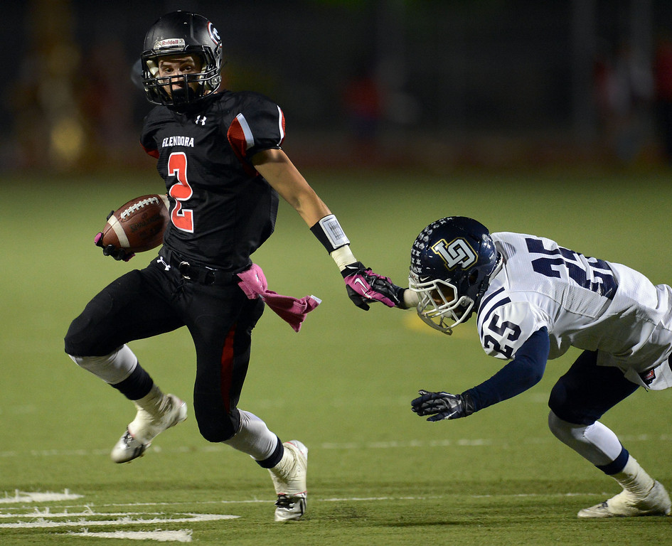 . Glendora\'s Briton Noskoff (2) runs past Los Osos\' Vincent Wilkes (25) for a first down in the first half of a prep football game at Citrus College in Glendora, Calif., on Thursday, Oct. 31, 2013.    (Keith Birmingham Pasadena Star-News)