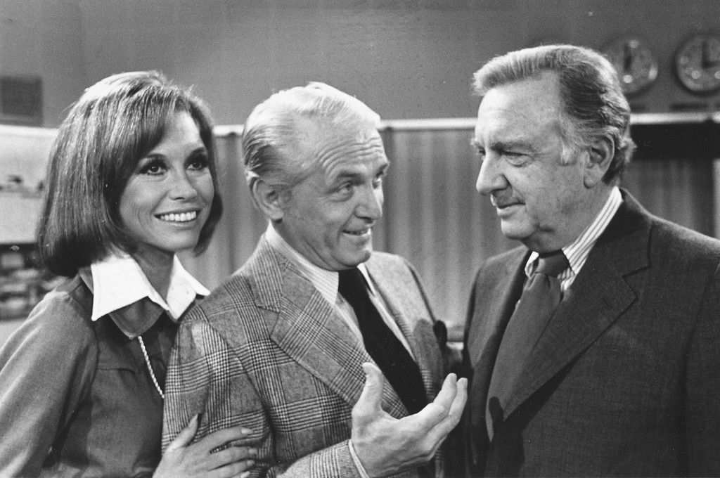 """. TV news commentator Walter Cronkite, right, meets with actor Ted Baxter and actress Mary Tyler Moore as he makes an appearance at the \""""Mary Tyler Moore Show,\"""" in Los Angeles, Calif., on February 4, 1974.   (AP Photo)    )"""