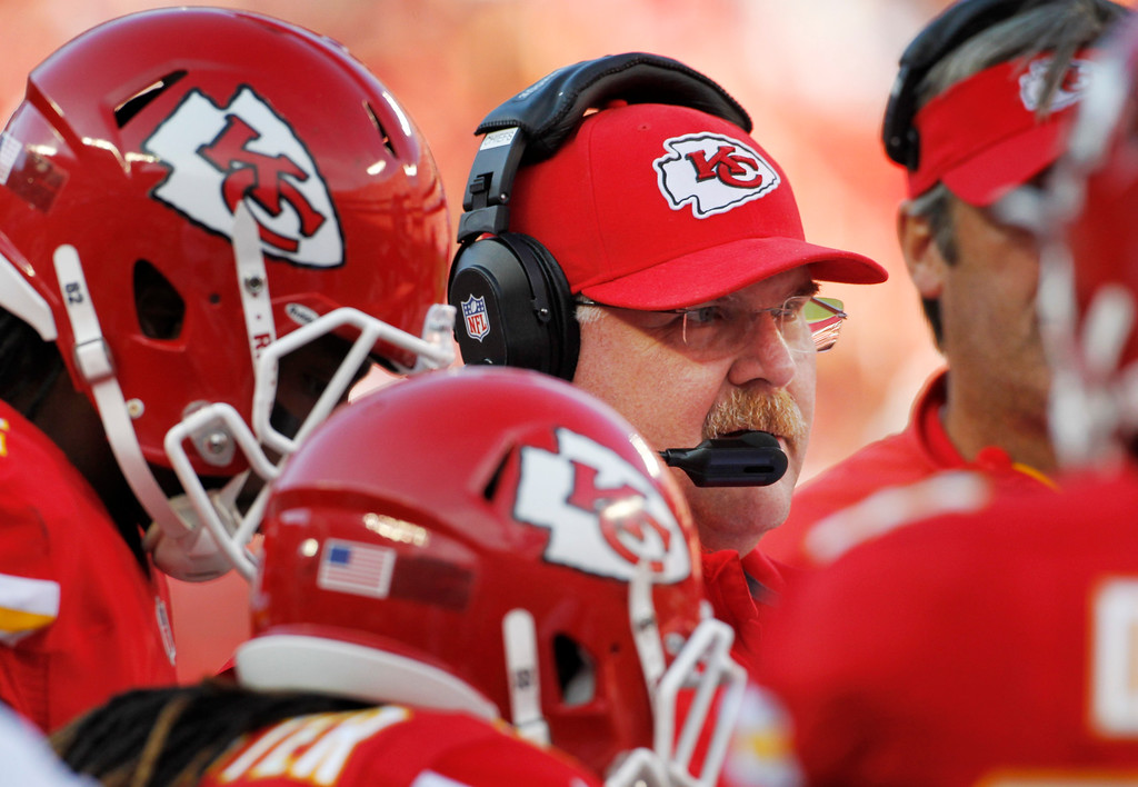 . Kansas City Chiefs coach Andy Reid stands with his players during the first half of an NFL football game against the Houston Texans at Arrowhead Stadium in Kansas City, Mo., Sunday, Oct. 20, 2013. (AP Photo/Colin E. Braley)