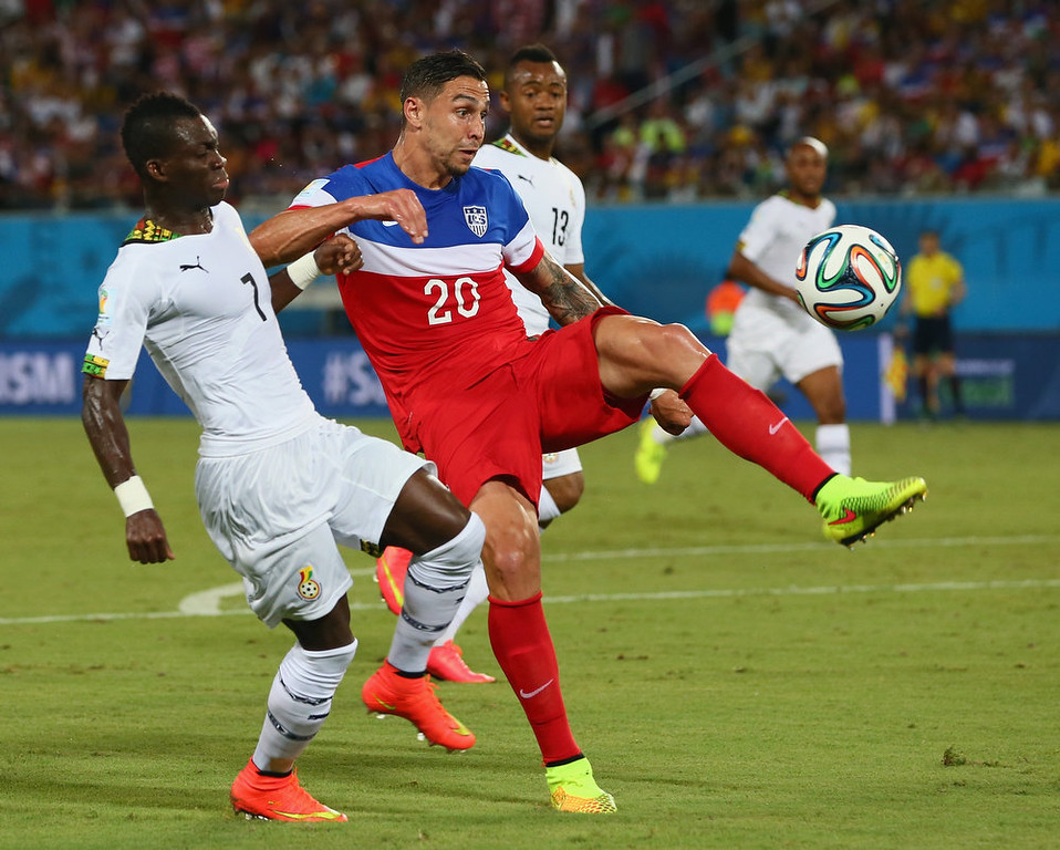 . Geoff Cameron of the United States competes for the ball with Christian Atsu of Ghana during the 2014 FIFA World Cup Brazil Group G match between Ghana and the United States at Estadio das Dunas on June 16, 2014 in Natal, Brazil.  (Photo by Kevin C. Cox/Getty Images)
