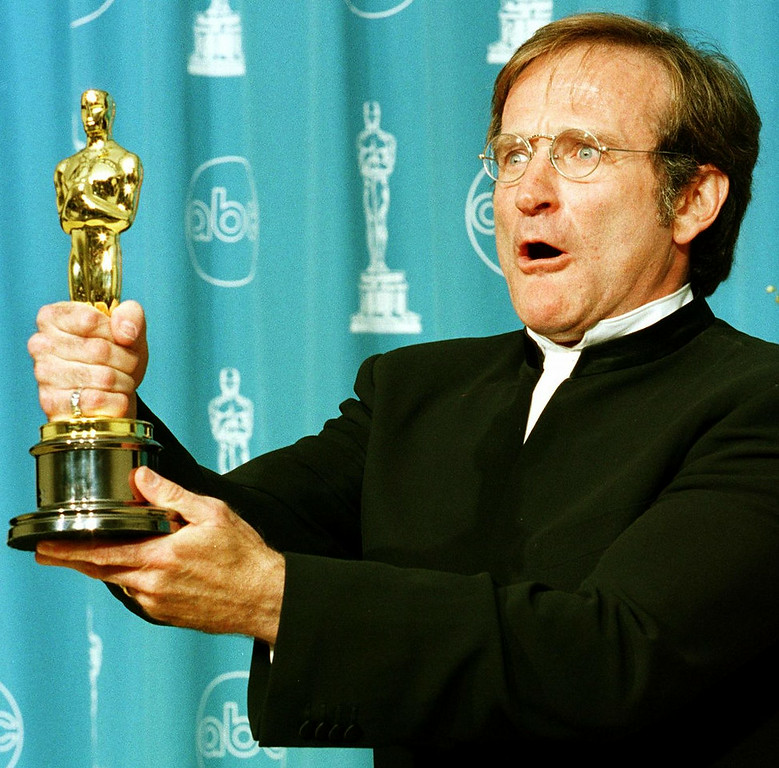 ". Actor Robin Williams holds the Oscar he won for Best Supporting Actor for his role in ""Good Will Hunting\"" during the 70th Annual Academy Awards 23 March in Los Angeles, CA.  HAL GARB/AFP/Getty Images"
