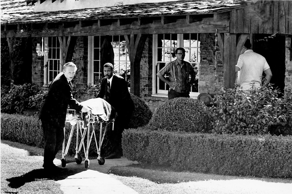 . The body of actress Sharon Tate is taken from her rented house on Cielo Drive in Beverly Hills, Calif., on Aug. 9, 1969. Tate, who was eight months pregnant, and four other persons were found murdered by American cult-leader Charles Manson and his followers. Tate, the wife of director Roman Polanski, was born in 1943. (AP Photo)