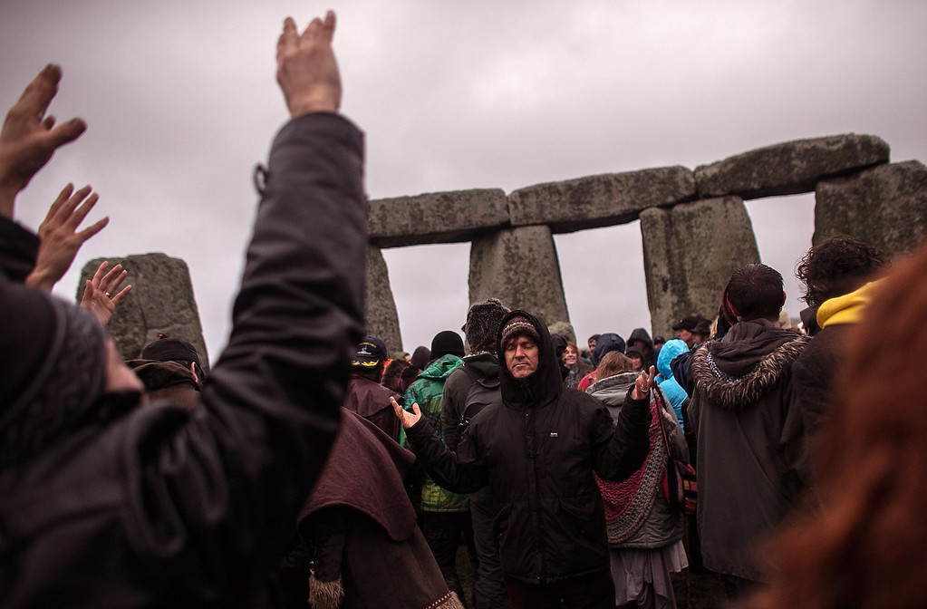 . Druids, pagans and revelers gather in the centre of Stonehenge, hoping to see the sun rise, as they take part in a winter solstice ceremony at Stonehenge on December 21, 2013 in Wiltshire, England.  (Photo by Matt Cardy/Getty Images)