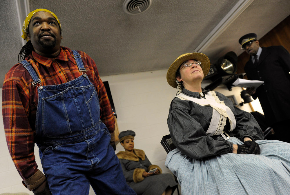 Description of . Members of the James P. Beckworth Mountain Club, historical reenactors from Denver, perform at the Colorado Railroad Museum in Golden as it hosts a Black History Month event, Black on Track: African American Connections and Stories. From left to right are Stephan Griffin, Deanna Lowman (background), Lynne Lawlor, and Sid Wilson. The reenactors gave visitors an experience of the African American connections and stories that contributed to both the railroad and cultural history of Colorado. Kathryn Scott Osler, The Denver Post