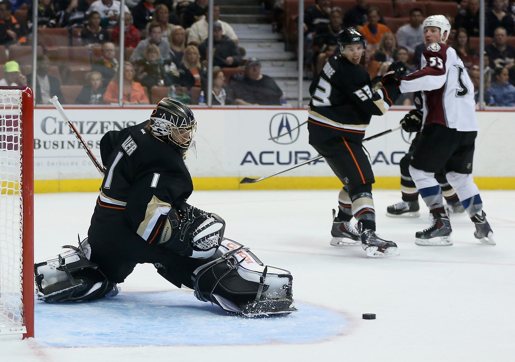. Goaltender Jonas Hiller #1 of the Anaheim Ducks makes a kick save against the Colorado Avalanche in the second period at Honda Center on September 22, 2013 in Anaheim, California. The Avalanche defeated the Ducks 2-1.  (Photo by Jeff Gross/Getty Images)
