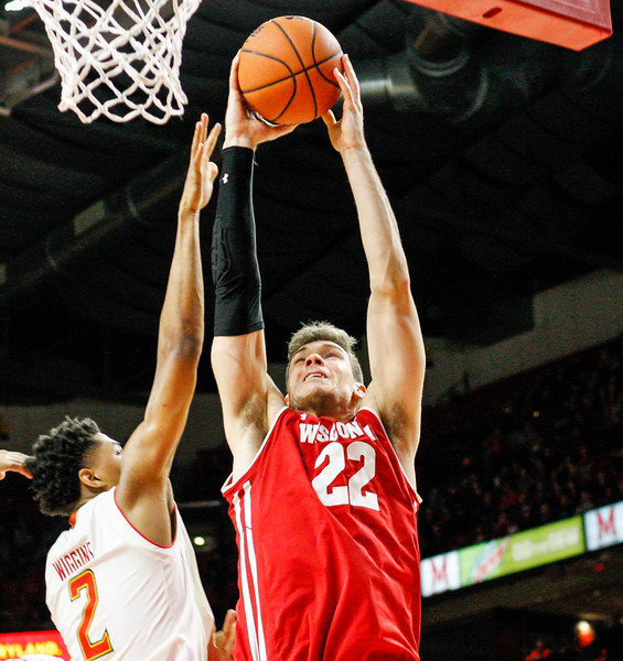 January 20, 2018: Wisconsin forward Ethan Happ (22) goes for a dunk past Maryland guard Aaron Wiggins (2) during BIG Ten Men Basketball action between University of Wisconsin and University of Maryland in College Park. Photo by: Chris Thompkins/Prince Georges Sentinel