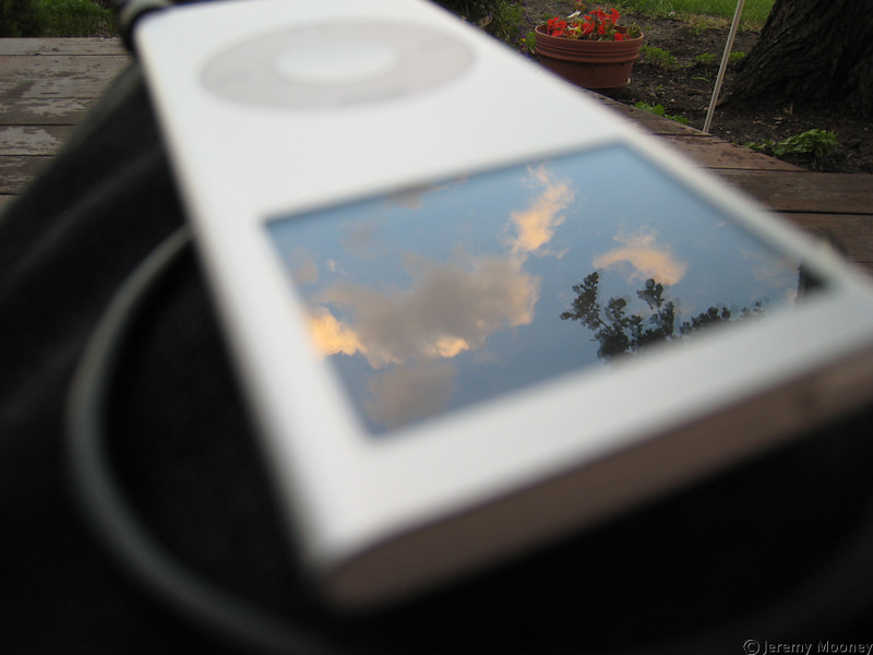 Reflections - the sky on my iPod screen, focus on the sky