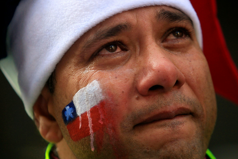 . A Chile soccer fan cries after his team was defeated by Brazil in a World Cup round of 16 match, as he watches the game on TV in Santiago, Chile, Saturday, June 28, 2014. Chile lost the match to Brazil 3-2 on penalties after the game ended 1-1. (AP Photo/Luis Hidalgo)