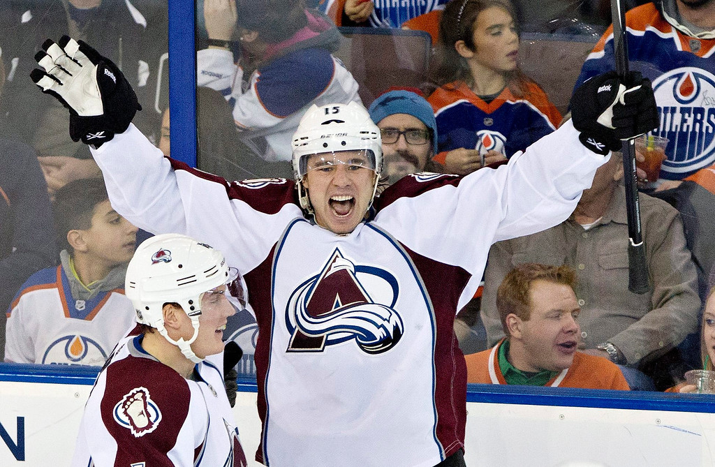 . Colorado Avalanche\'s Tyson Barrie (4) and PA Parenteau (15) celebrate a goal against the Edmonton Oilers during second-period NHL hockey game action in Edmonton, Alberta, Thursday, Dec. 5, 2013. (AP Photo/The Canadian Press, Jason Franson)