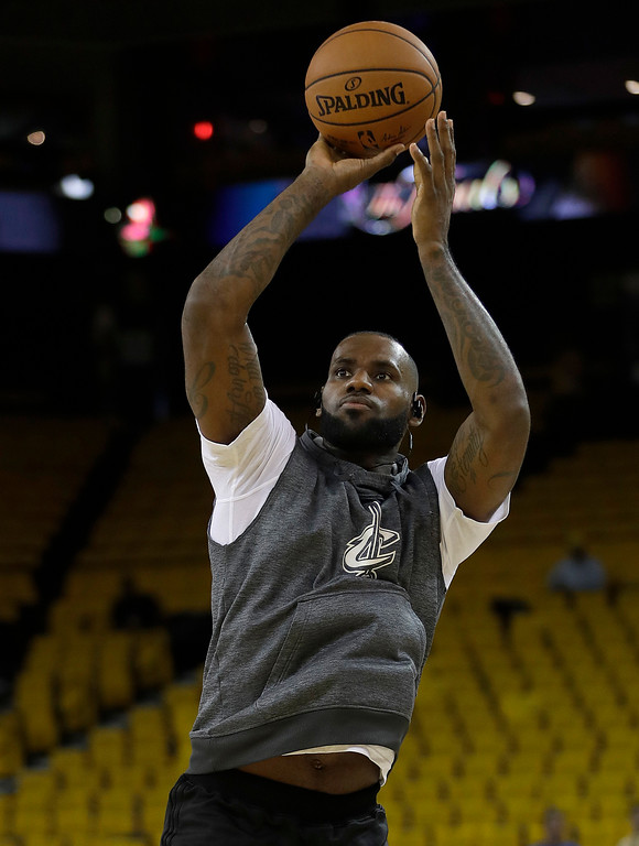 . Cleveland Cavaliers forward LeBron James warms up before Game 1 of basketball\'s NBA Finals between the Golden State Warriors and the Cavaliers in Oakland, Calif., Thursday, June 1, 2017. (AP Photo/Marcio Jose Sanchez)
