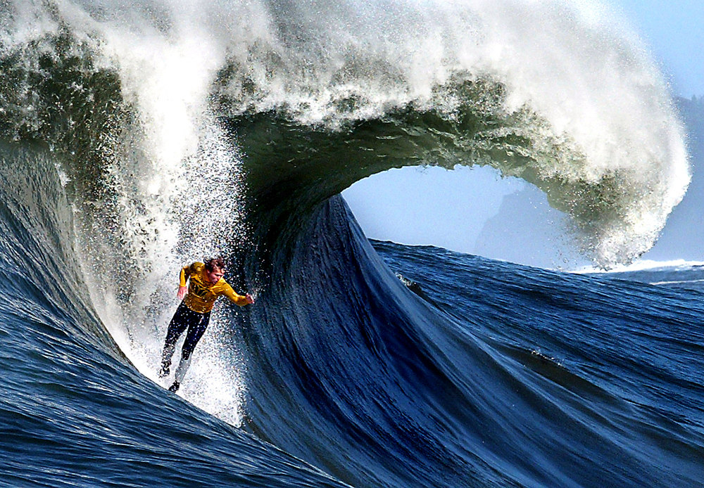 Description of . A huge barrel forms behind surfer Russell Smith, of Santa Cruz, California  as he challenges a Mavericks monster during the annual Mavericks Surf Contest on March 2, 2005.  The contest takes place in a legendary break in the Pacific Ocean one-half mile off the coast of Half Moon Bay, California . Photo by Shmuel Thaler/Santa Cruz Sentinel