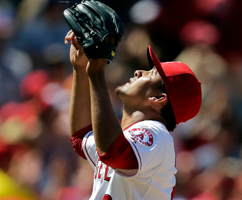 . Angels closer Ernesto Frieri celebrates his team\'s 1-0 win over the Twins, earning his 25th save. (AP Photo/Jae C. Hong)