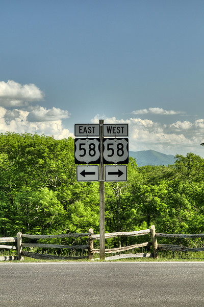 Road signs marking Highway 58, the main thoroughfare in the area, at the enrance to Grayson Highlands State Park in Mouth of Wilson, VA on Friday, May 31, 2013. Copyright 2013 Jason Barnette