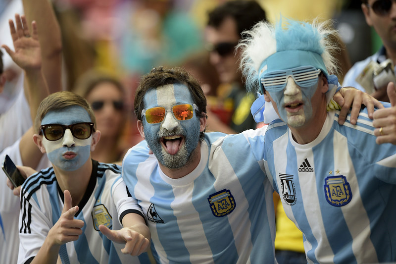 . Argentina\'s fans cheer before a quarter-final football match between Argentina and Belgium at the Mane Garrincha National Stadium in Brasilia during the 2014 FIFA World Cup on July 5, 2014. (JUAN MABROMATA/AFP/Getty Images)