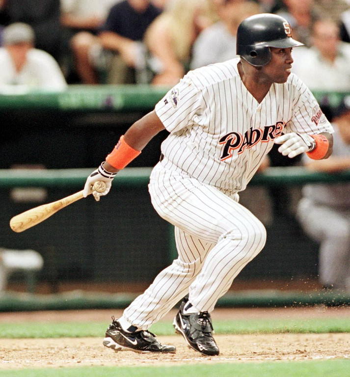 . National League player Tony Gwynn hits a single for two runs during the third inning of the 1998 Major League All-Star game 07 July at Coors Field in Denver, Colorado.    JEFF HAYNES/AFP/Getty Images
