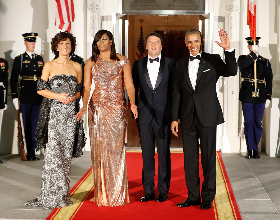 . President Barack Obama and first lady Michelle Obama pose for a photo as they greet Italian Prime Minister Matteo Renzi and his wife Agnese Landini on the North Portico for a State Dinner at the White House in Washington, Tuesday, Oct. 18, 2016. (AP Photo/Pablo Martinez Monsivais)