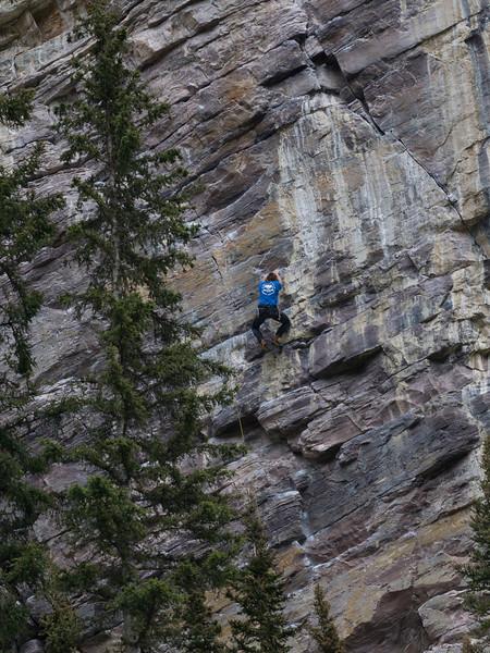 Person climbing rock, Lake Louise, Improvement District 9, Banff National Park, Alberta, Canada