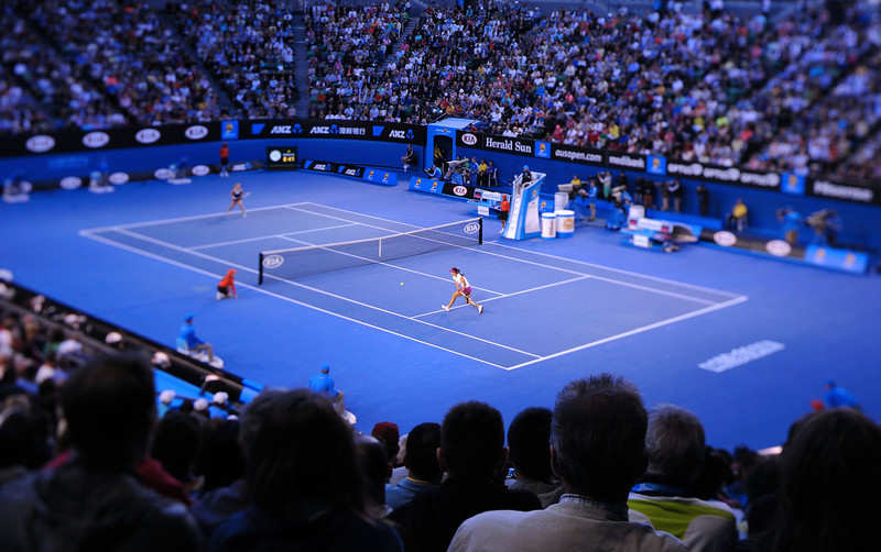 . In this photograph taken with a Tilt and Shift lens, China\'s Li Na (R) plays a shot during her women\'s singles final match against Slovakia\'s Dominika Cibulkova (L) on day thirteen of the 2014 Australian Open tennis tournament in Melbourne on January 25, 2014. (MAL FAIRCLOUGH/AFP/Getty Images)